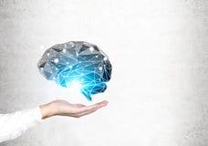 Man s hand holding brain hologram, concrete Stock Photos