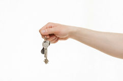Man's hand holding a bunch of keys. White background Royalty Free Stock Images