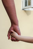 Man's hand is holding child's hand Royalty Free Stock Photo