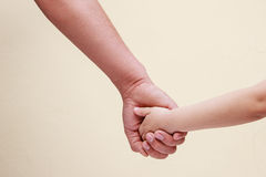 Man's hand is holding child's hand Stock Photos