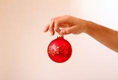 Man's hand holding Christmas ball  Stock Photography