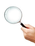 Man's hand holding classic magnifying glas Royalty Free Stock Image