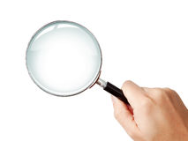Man's hand holding classic magnifying glas Stock Image