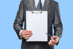 Man's hand holding clipboard Royalty Free Stock Images