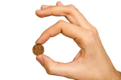 Man's hand holding coin Stock Photo
