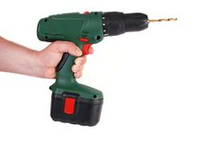 Man's hand holding drill royalty free stock photos
