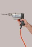Man's hand holding a drill Royalty Free Stock Images