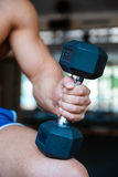 Man's hand holding dumbbell royalty free stock photography