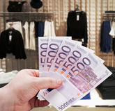 Hand holding euro to new shopping in the supermarket royalty free stock photography