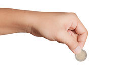 Man's hand, holding 2 Euros coin Royalty Free Stock Photo
