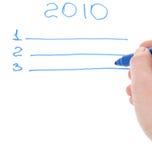 Man's hand holding a felt-tip. Man's hand holding a blue felt-tip on form of plan Stock Image