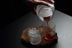 Man`s hand holding a galss jar. Hot and cold coffee Stock Images