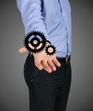Man's hand holding a gear mechanism Royalty Free Stock Photo