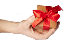Man's hand holding gift box Royalty Free Stock Image
