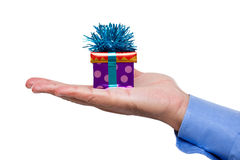 Man's hand holding a gift Royalty Free Stock Photography