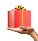 Man's hand holding a gift on palm. Man's hand holding a red shiny gift on palm, viewed from a side. On white background. Clipping path included Royalty Free Stock Photo
