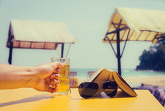 Man's hand holding a glass of beer Royalty Free Stock Images