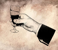 The man's hand holding glasses of champagne. Offset printing desig.On old vintage background Royalty Free Stock Image