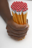 Man's Hand Holding Group Of Pencils Royalty Free Stock Photos