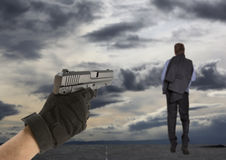 Man's hand holding gun Royalty Free Stock Photography