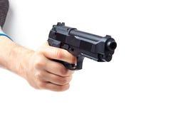 Man's hand holding gun,  on white. Royalty Free Stock Image