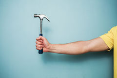 Man's hand holding hammer Royalty Free Stock Photos