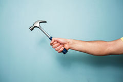 Man's hand holding hammer Stock Photo