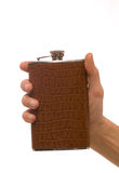 Man's hand holding hipflask Stock Photos