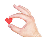 Man's hand holding a human heart. Stock Images