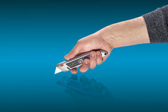 Man's hand holding a knife stationery Royalty Free Stock Photography