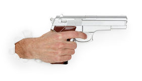 Man's hand holding a large silver handgun Royalty Free Stock Images