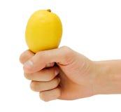 Man's hand holding a lemon Royalty Free Stock Photo