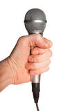 Man's hand holding a microphone Royalty Free Stock Photos