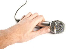 Man's hand holding a microphone Stock Photography