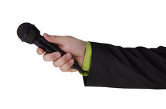 Man's hand holding a microphone Stock Photos