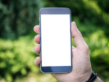 Man's hand holding mobile smartphone Stock Photography