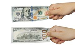 A man's hand holding a one hundred dollar bill Royalty Free Stock Image