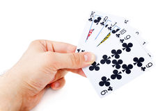 Man's hand holding playing cards Royalty Free Stock Photos