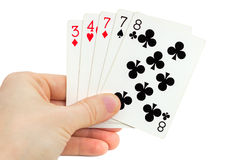 Mans hand holding playing cards (one pair) Stock Photo