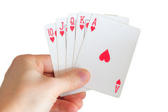 Mans hand holding playing cards (straight/royal flush) Stock Images