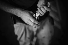 Man's hand holding a pliers Royalty Free Stock Photography