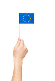 Man`s hand holding and raising European Union flag Royalty Free Stock Photos
