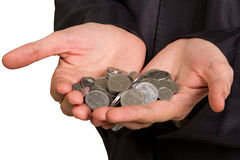 Man's hand holding  silver coins Stock Images