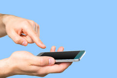 Man's hand holding smartphone Royalty Free Stock Images