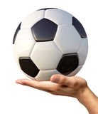 Man's hand holding a soccer ball on palm. Man's hand holding a soccer ball on palm, viewed from a side. On white background. Clipping path included Royalty Free Stock Images