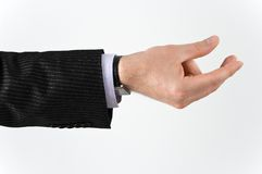 Man's hand holding something. Well shaped man's hand holding something isolated over white Royalty Free Stock Photography