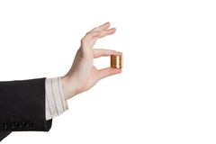 Man's hand holding a stack of coins Royalty Free Stock Images