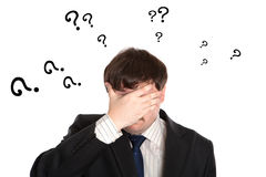 Businessman in stress with questions Stock Images