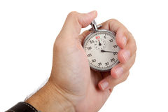 A man's hand holding a stop watch Stock Image