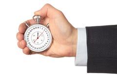 Man's hand holding stopwatch. Stock Image
